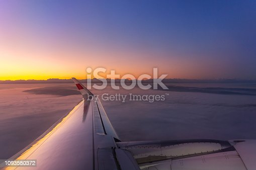 902818356 istock photo Amazing cloud cover Zurich city in Switzerland from window view of airplane from Switzerland to Copenhagen Denmark in the awesome sunset sky 1093580372
