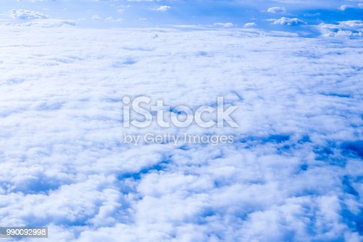 istock Amazing clouds from airplane on blue sky 990092998