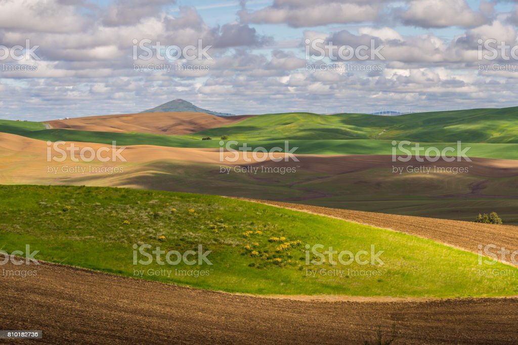 Amazing clouds over plowed fields, an incredible drawing of the earth stock photo