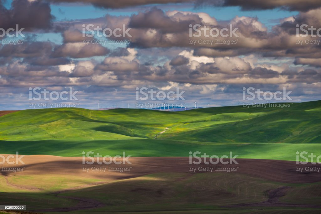 Amazing clouds over plowed fields, an incredible drawing of the earth. stock photo