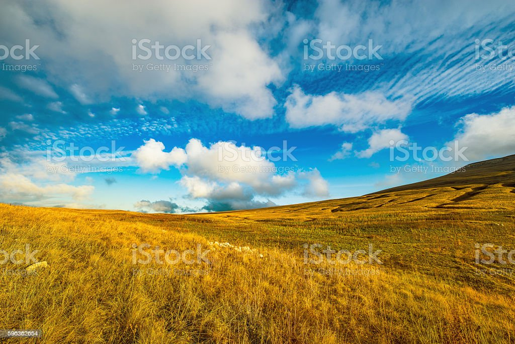 Amazing cloudscape above the mountain meadow. royalty-free stock photo