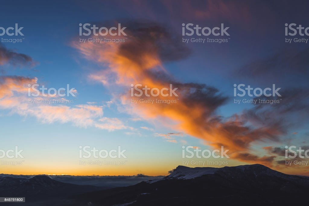 Amazing Colorful Sunset High In Mountains Orange Clouds And Blue Sky Stock Photo Download Image Now