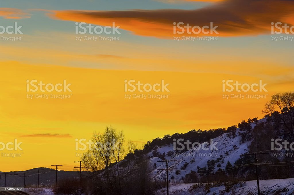 Amazing Colorful Sunset with Lenticular Cloud and Hills royalty-free stock photo