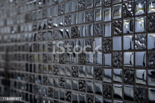 amazing decorative wall made of small smooth glass blocks with different texture in home kitchen extreme close view