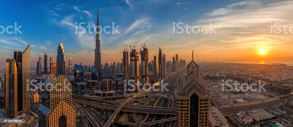 Amazing Dubai skyline at sunset stock photo
