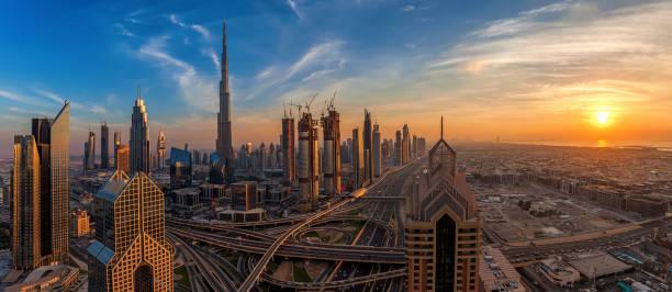 Amazing Dubai skyline at sunset stock photo