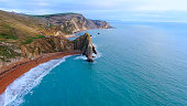 istock Amazing Durdle Door at the Jurassic Coast of England - view from above 1220187724