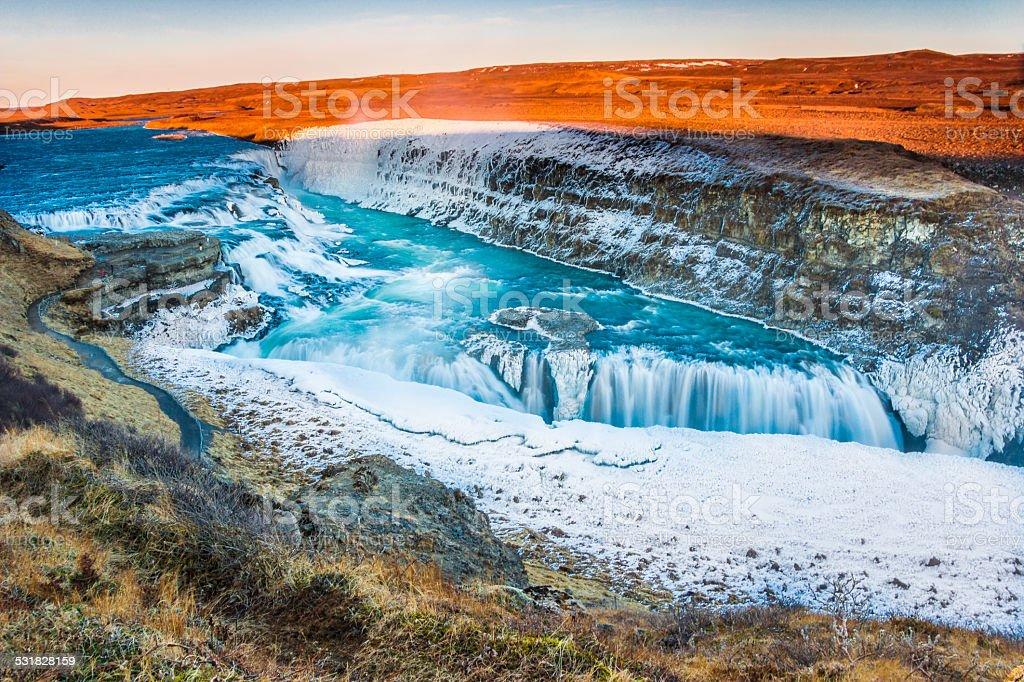 Amazing Icelandic winter landscape of majestic waterfall of frozen Gullfoss stock photo