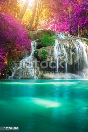 istock Amazing in nature, beautiful waterfall at colorful autumn forest in fall season 1182604867