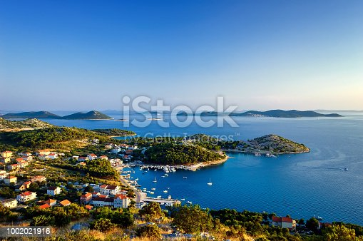 Amazing Kornati archipelago of Croatia. Northern part of Dalmatia. Sunny detail of Stomorski islands. Beautiful summer seascape with clear water from Zadar to Sibenik.
