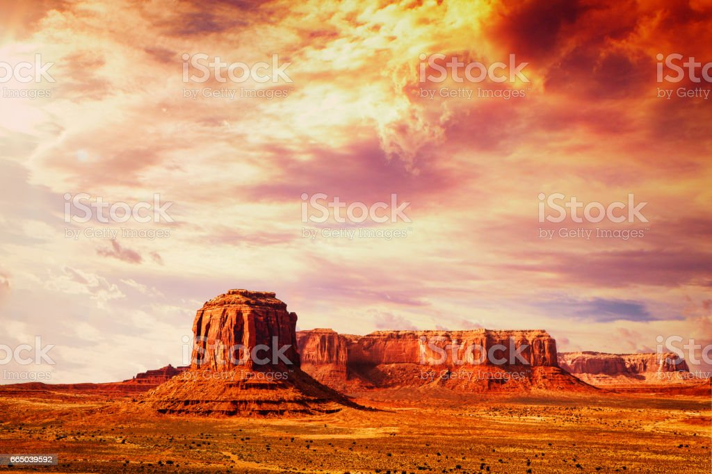 amazing landscape at the sunset at the monument valley national park in arizona USA with cloudy and drama sky stock photo