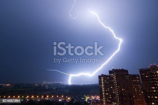 1144340539 istock photo Amazing lightning strike over city. 624682984