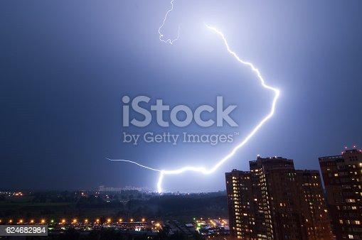 1144340518istockphoto Amazing lightning strike over city. 624682984