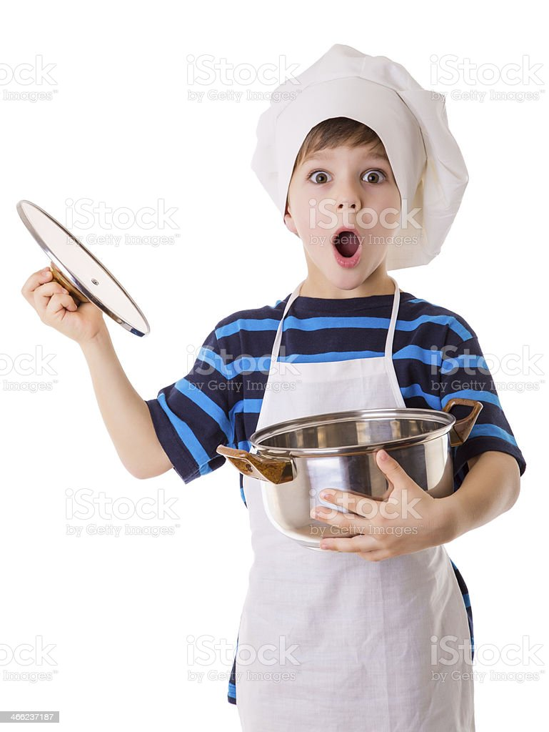 Amazing little chef opens the pot stock photo