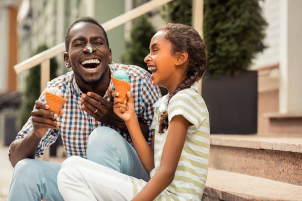 Amazing little female laughing at her daddy stock photo