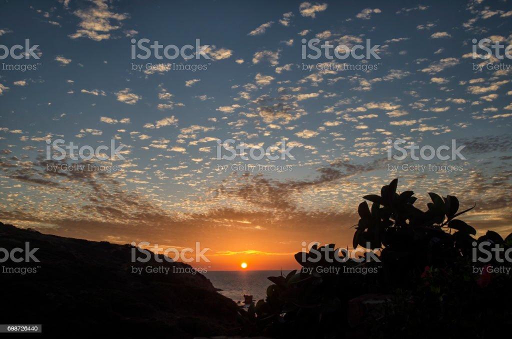 Amazing mackerel sky over the Italian coast stock photo