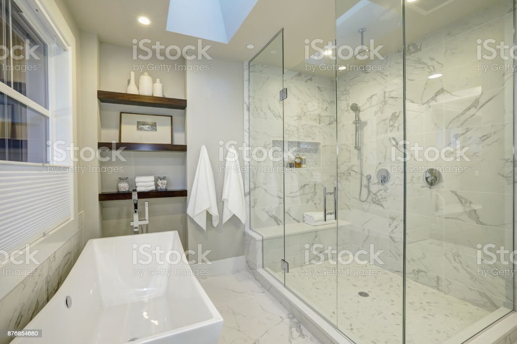 Amazing master bathroom with large glass walk-in shower stock photo