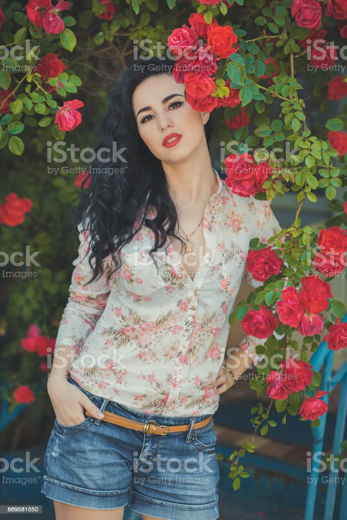 Amazing mystic lady woman with black dark curly hairs pink cheeks...