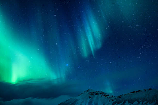 Amazing Northern light Amazing view on the Northen light over high mountains covering with snow, forces of nature, Aurora Borealis, Iceland north star stock pictures, royalty-free photos & images