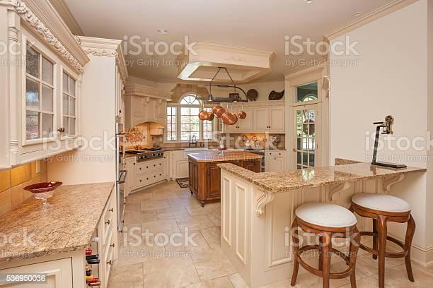 Amazing ornate kitchen with marble counter tops picture id536950036?b=1&k=6&m=536950036&s=612x612&h=vukkfzmxenfqc6dzrugusbaa66taxtd nrhkv aqk70=