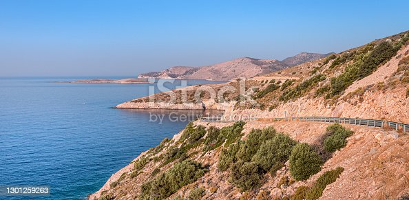 Amazing outlines of the Dodecanese Islands and capes in the early morning at sunrise. View of the coastal strip of the Aegean sea and the road traversing the Datca Peninsula in Turkey.