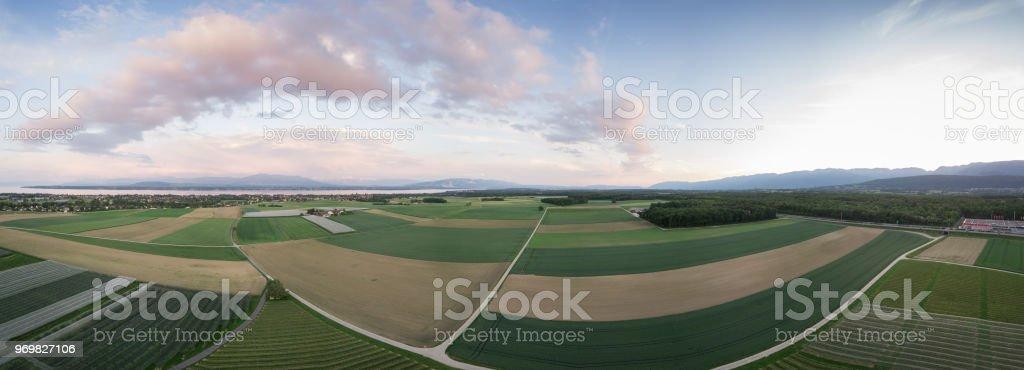 Amazing panorama of green fields stock photo