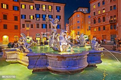 istock Amazing panoramic view   of the Fountain of Neptune in Piazza Navona at night. Rome, Italy 862620700