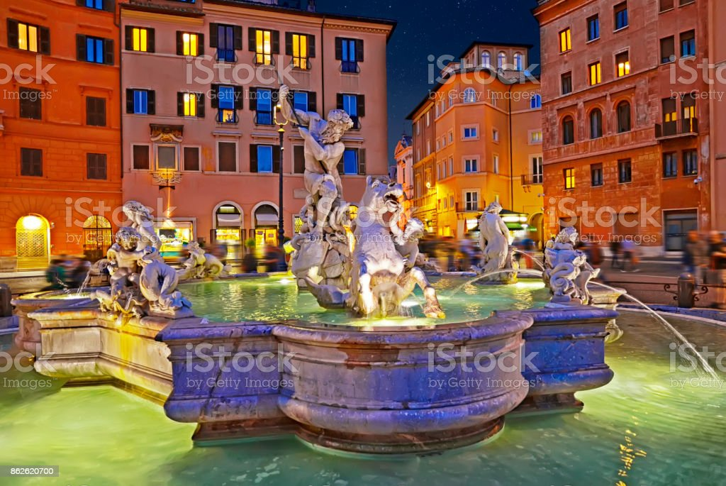 Amazing panoramic view   of the Fountain of Neptune in Piazza Navona at night. Rome, Italy stock photo