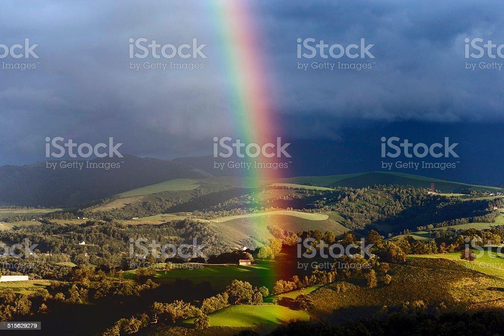 Amazing Rainbow in landscape - France stock photo