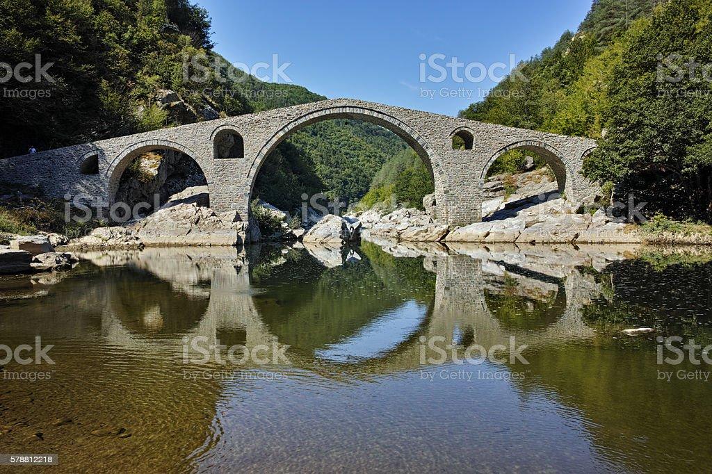 Amazing Reflection of The Devil's Bridge in Arda river, Bulgaria stock photo