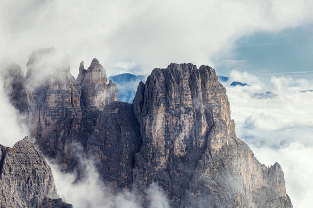 Amazing rocky mountains covered with clouds, Tre Cime di Lavaredo park stock photo