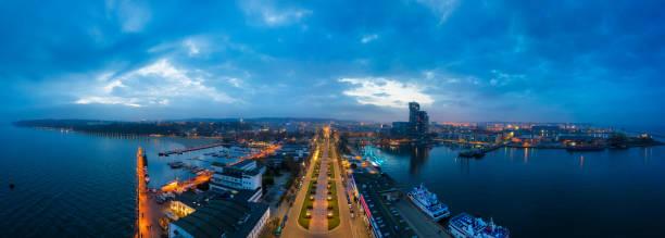 amazing scenery of kosciuszko square in gdynia by the baltic sea at dusk - drone shipyard night imagens e fotografias de stock