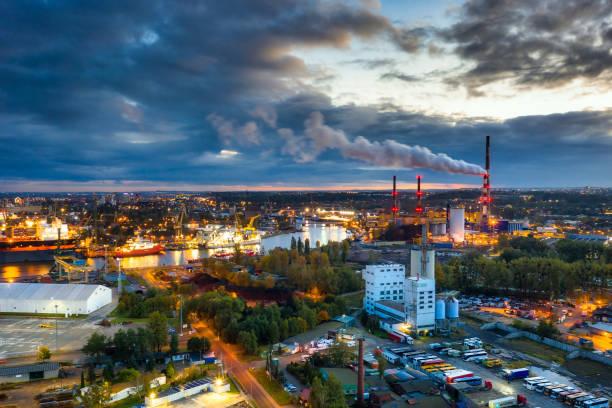 amazing scenery of the shipyard and canals of gdansk at dusk. poland - drone shipyard night imagens e fotografias de stock