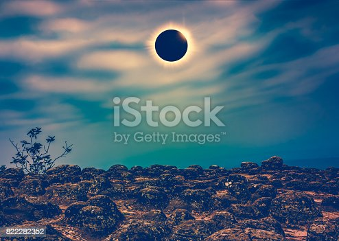 istock Amazing scientific natural phenomenon. Total solar eclipse glowing on sky. 822282352