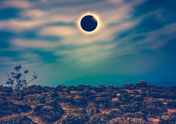 Amazing scientific natural phenomenon. Total solar eclipse glowing on sky. stock photo