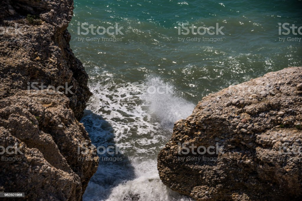 Amazing sea with blue summer wave and rocks, relaxing view of rocks and water, - Royalty-free At The Edge Of Stock Photo