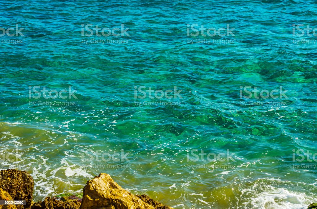 Amazing sea with blue summer wave and rocks, relaxing view of rocks and water - Royalty-free At The Edge Of Stock Photo