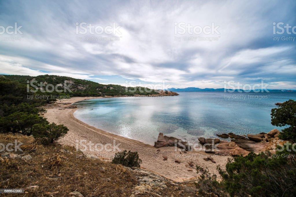 Amazing seascape of a turquoise sea in Italy. Beautiful wild beach of the Emerald coast in Sardinia. royalty-free stock photo
