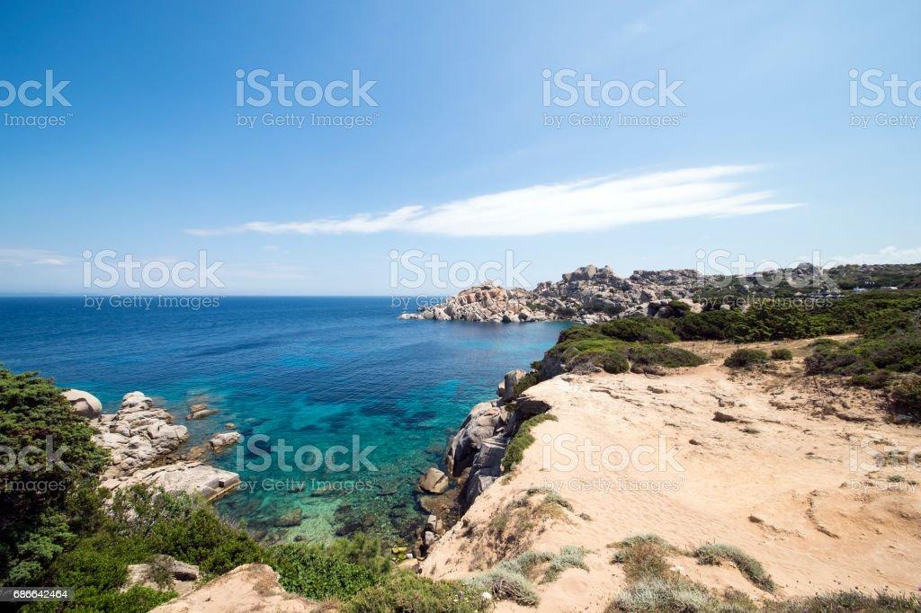 Amazing seascape of a turquoise sea in Italy. Beautiful wild beach of the Emerald coast in Sardinia. Стоковые фото Стоковая фотография