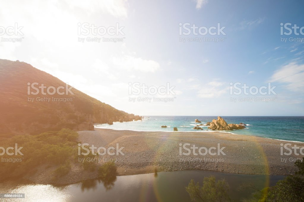 Amazing seascape of a turquoise sea in Italy. Beautiful wild beach of the Emerald coast in Sardinia. 免版稅 stock photo