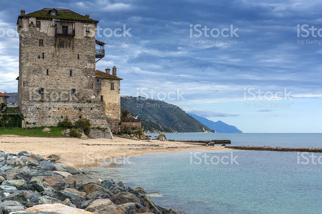 Amazing Seascape with Medieval tower in  Ouranopoli, Athos, Chalkidiki, Greece stock photo