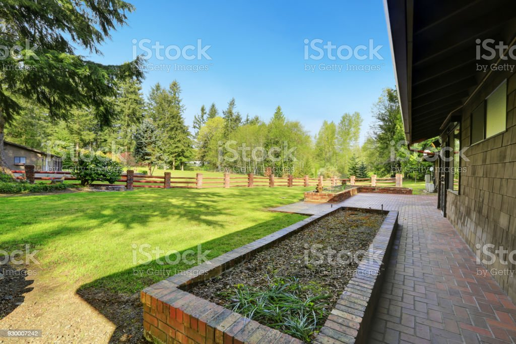 Amazing secluded home with large fenced frontyard area, stock photo