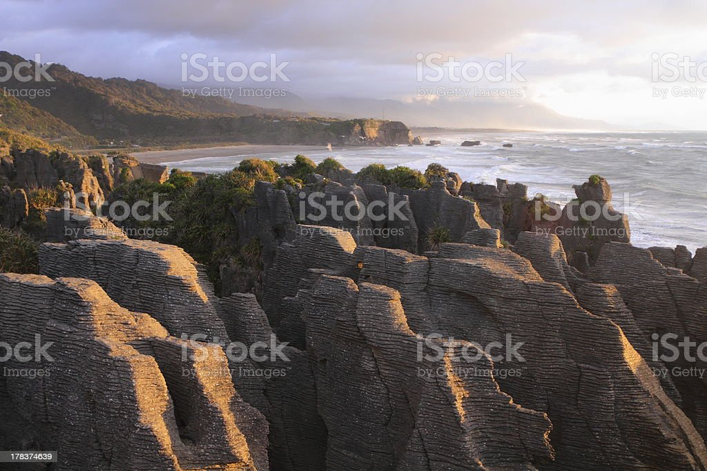 Amazing shapes of Pancake rocks at sunset stock photo