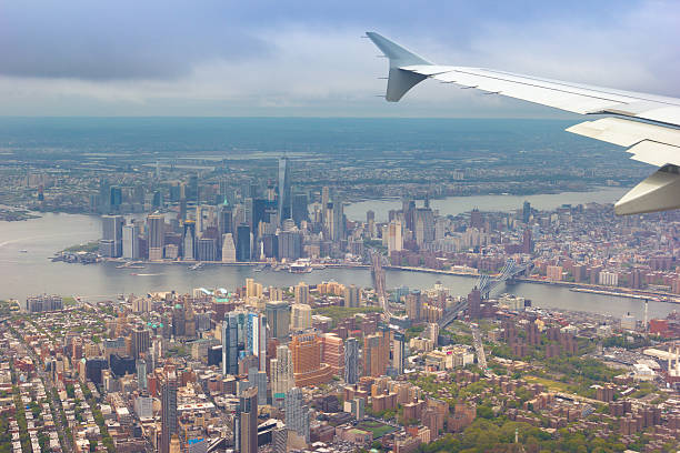 amazing shot of new york city shot from a plane - cursed stock pictures, royalty-free photos & images