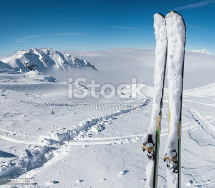 Panoramic view on snowcapped skis on the top of ski slope with view on the mountains. Val Thorens, France.