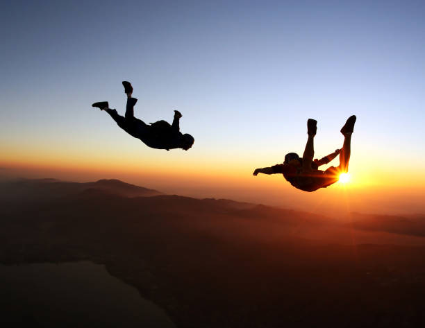 Amazing skydiving at the sunset Amazing skydiving at the sunset parachuting stock pictures, royalty-free photos & images