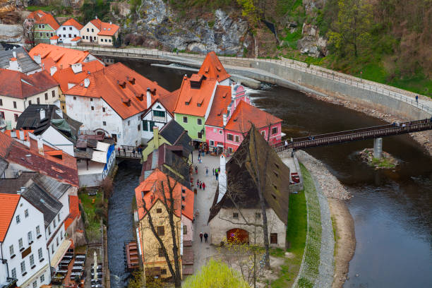 Amazing small island with the old mill. Cesky Krumlov, wonderful towon on the turn of the river. Cloudy spring weather. UNESCO World Heritage Site stock photo