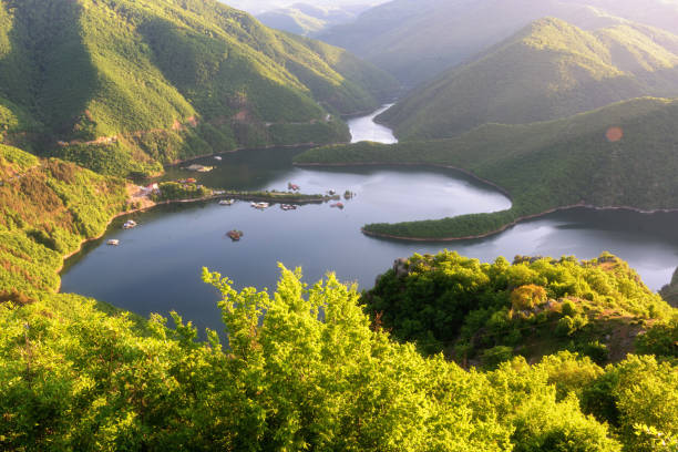 Amazing Spring landscape of Meander of Vacha (Antonivanovtsy) Reservoir, Rhodopes Mountain, Bulgaria stock photo