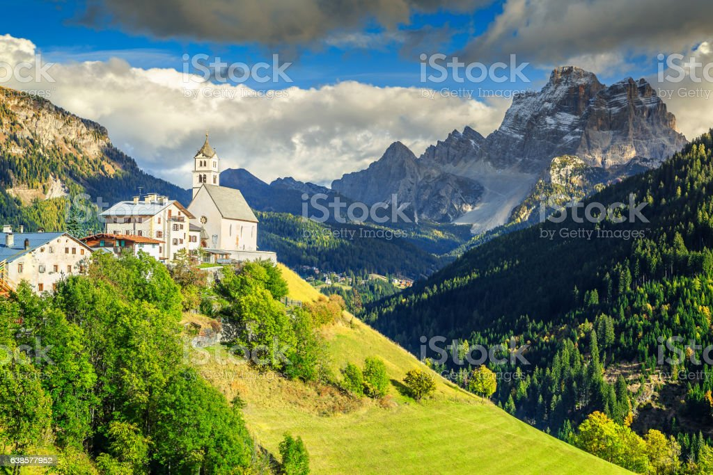 Amazing spring landscape with church on the hill, Dolomites, Italy stock photo