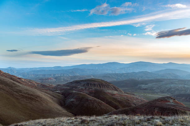 Amazing striped red mountains after sunset stock photo